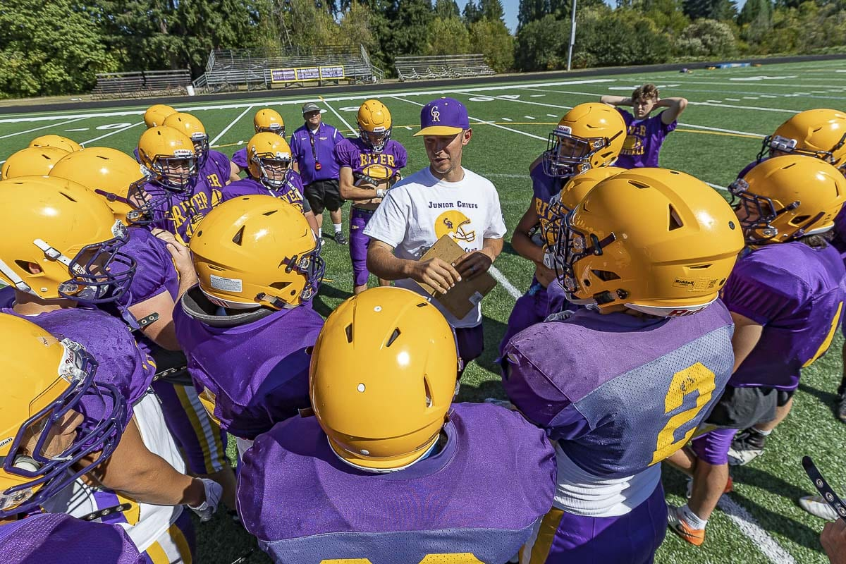 Columbia River coach Brett Smedley was thrilled for his players for picking up their first win of the season. His players celebrated Smedley's first win as head coach at River. Photo by Mike Schultz