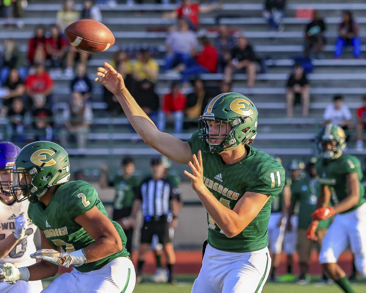 Carter Monda and the Evergreen passing game struggled early, but he completed 9 of his last 16 passes for 220 yards and four touchdowns. Photo by Mike Schultz