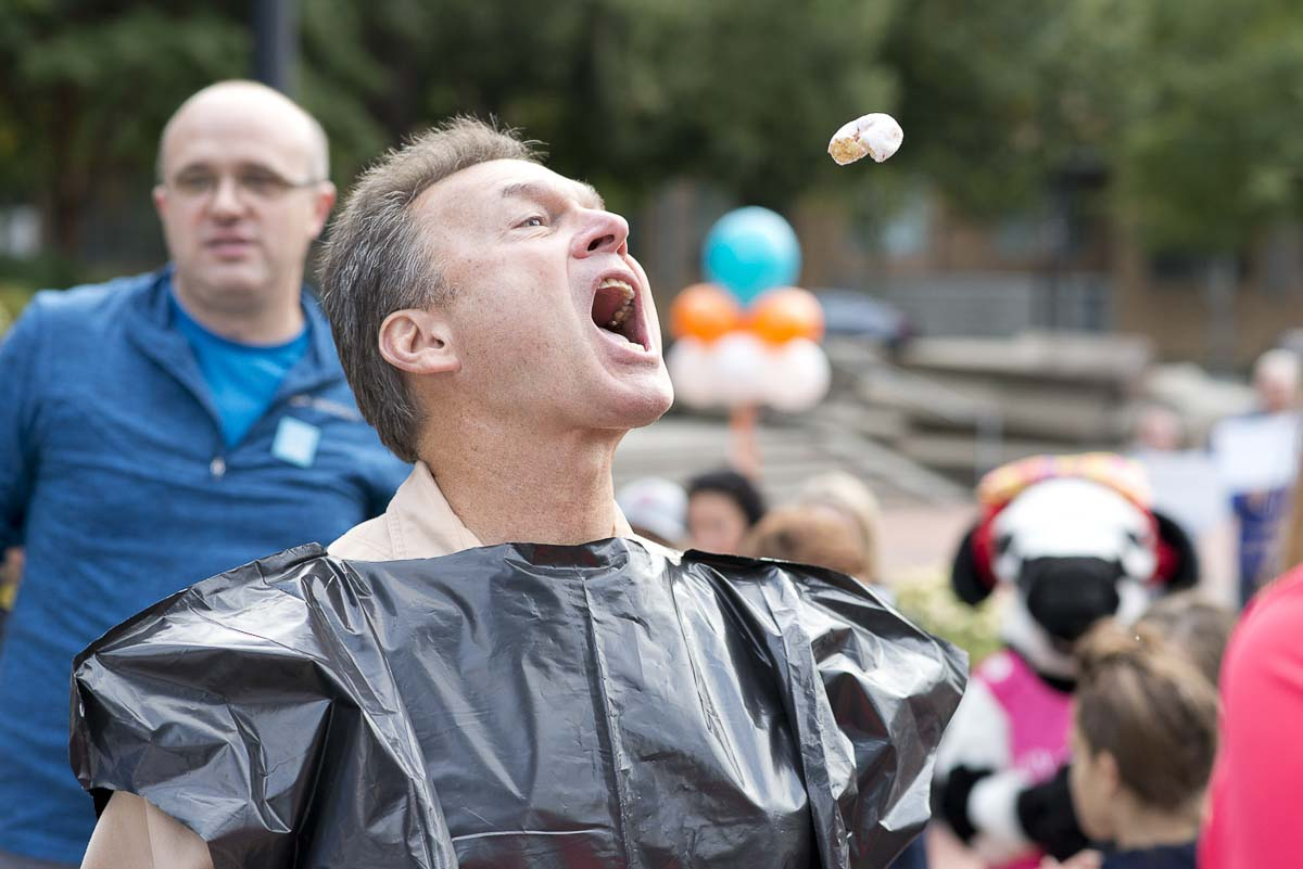 Mark Matthias, owner of Beaches Restaurant & Bar and board chair of the Community Foundation, takes part in a donut toss competition at the Give More 24! Rally. Photo courtesy of Community Foundation for Southwest Washington