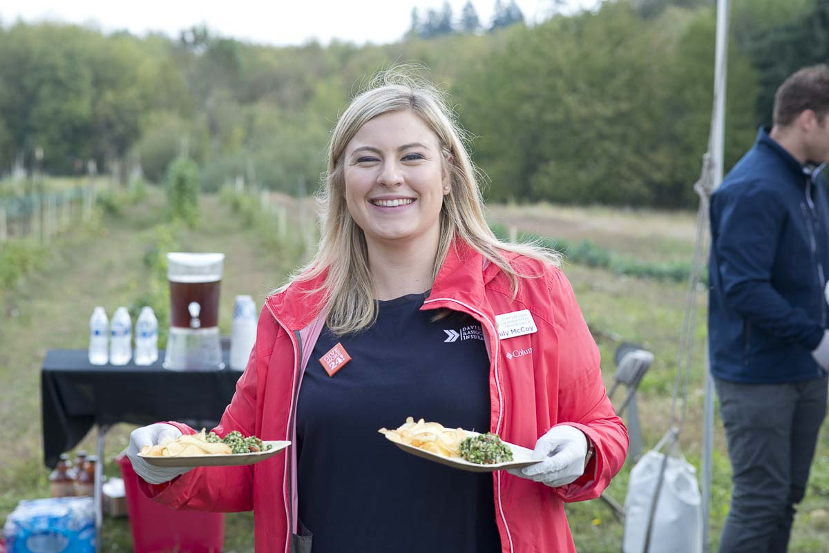 Emily McCoy from presenting sponsor Davidson & Associates Insurance serves meals at a farm to table lunch that supports a Partners in Careers' veterans program. Photo courtesy of Community Foundation for Southwest Washington