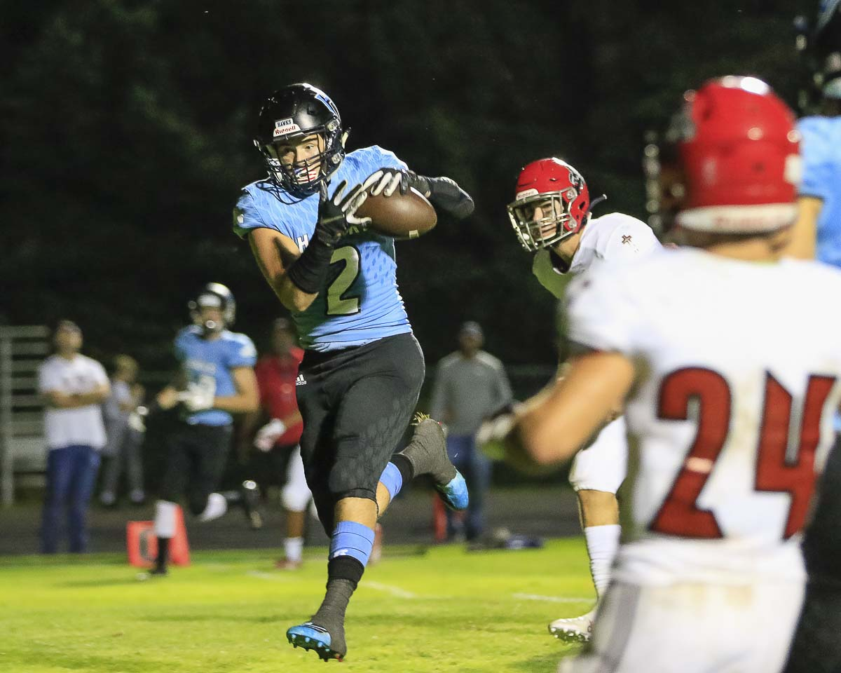 Hockinson tight end Jeremiah Faulstick (2) hauls in a pass that he converted into a touchdown in the Hawks' loss to Archbishop Murphy Friday. Photo by Mike Schultz