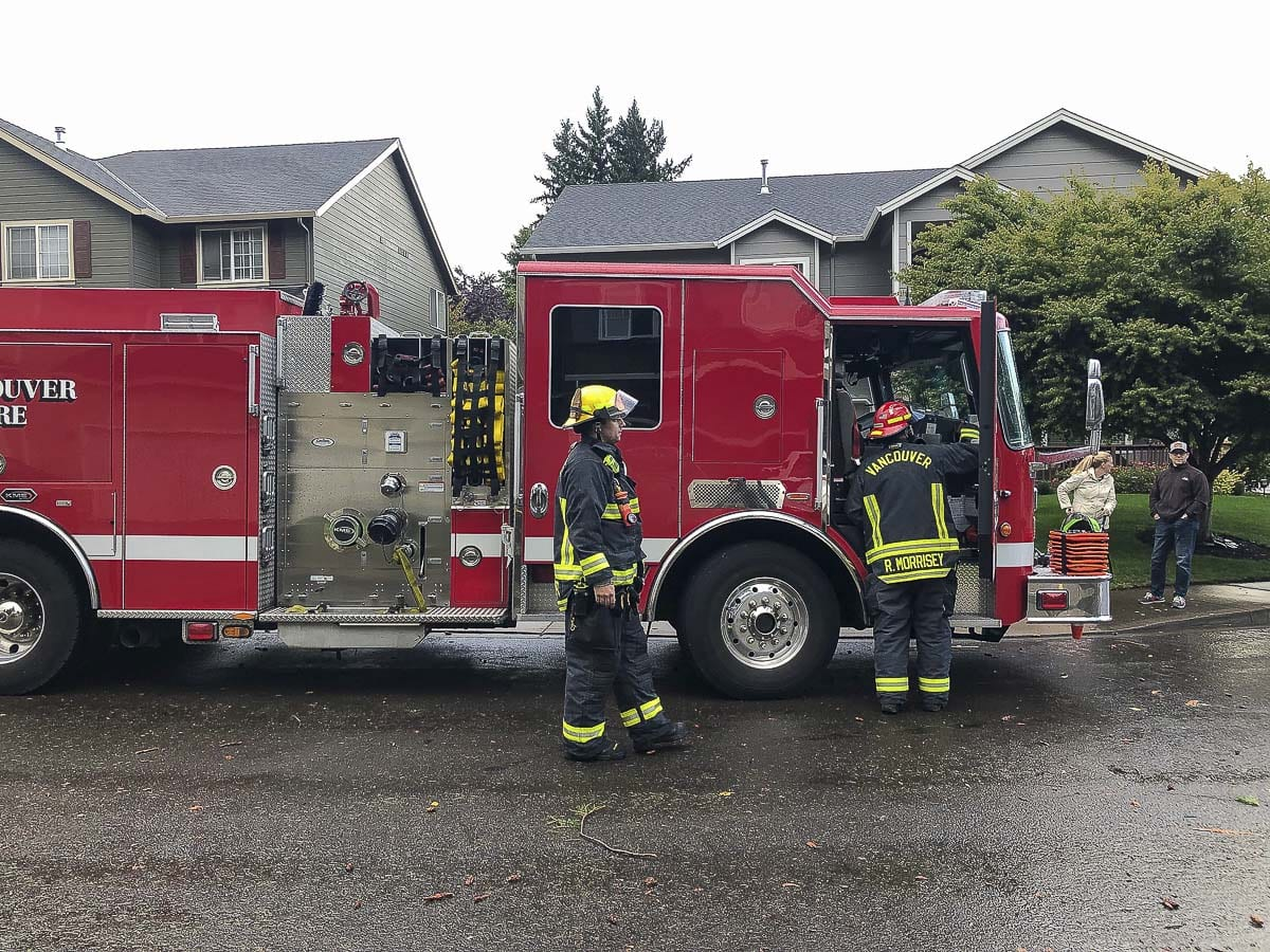 Vancouver Fire Department crews and other personnel responded to the east Vancouver home of Steve and Erica Pyne after the couple's home was struck by lightning Saturday afternoon. Photo by Andi Schwartz