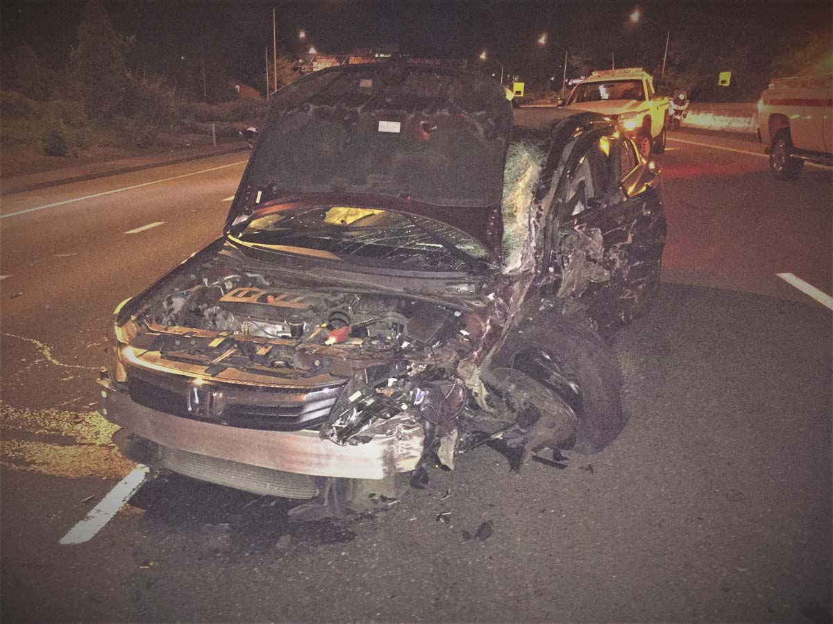 A Vancouver man driving his car the wrong way on the I-405 freeway crashed Saturday night and now faces charges. This vehicle shows the Honda sedan driven by 68-year-old Gerald Sullivan, who was cited for DUII. Photo courtesy of Portland Police Bureau
