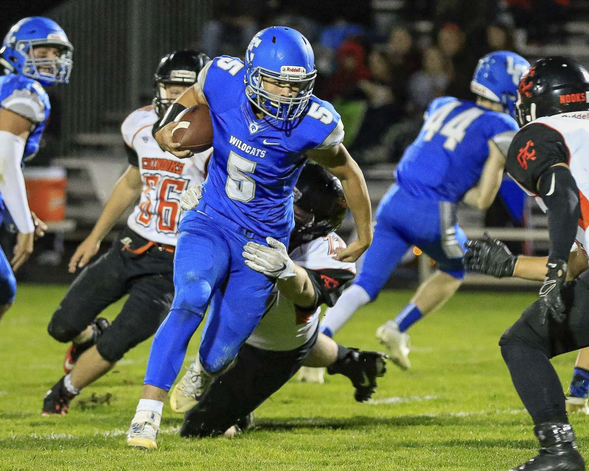 La Center running back Bryten Schmitz (5) looks for some yards against Kalama Friday. Schmitz had 137 yards rushing and also had a touchdown for the Wildcats. Photo by Mike Schultz