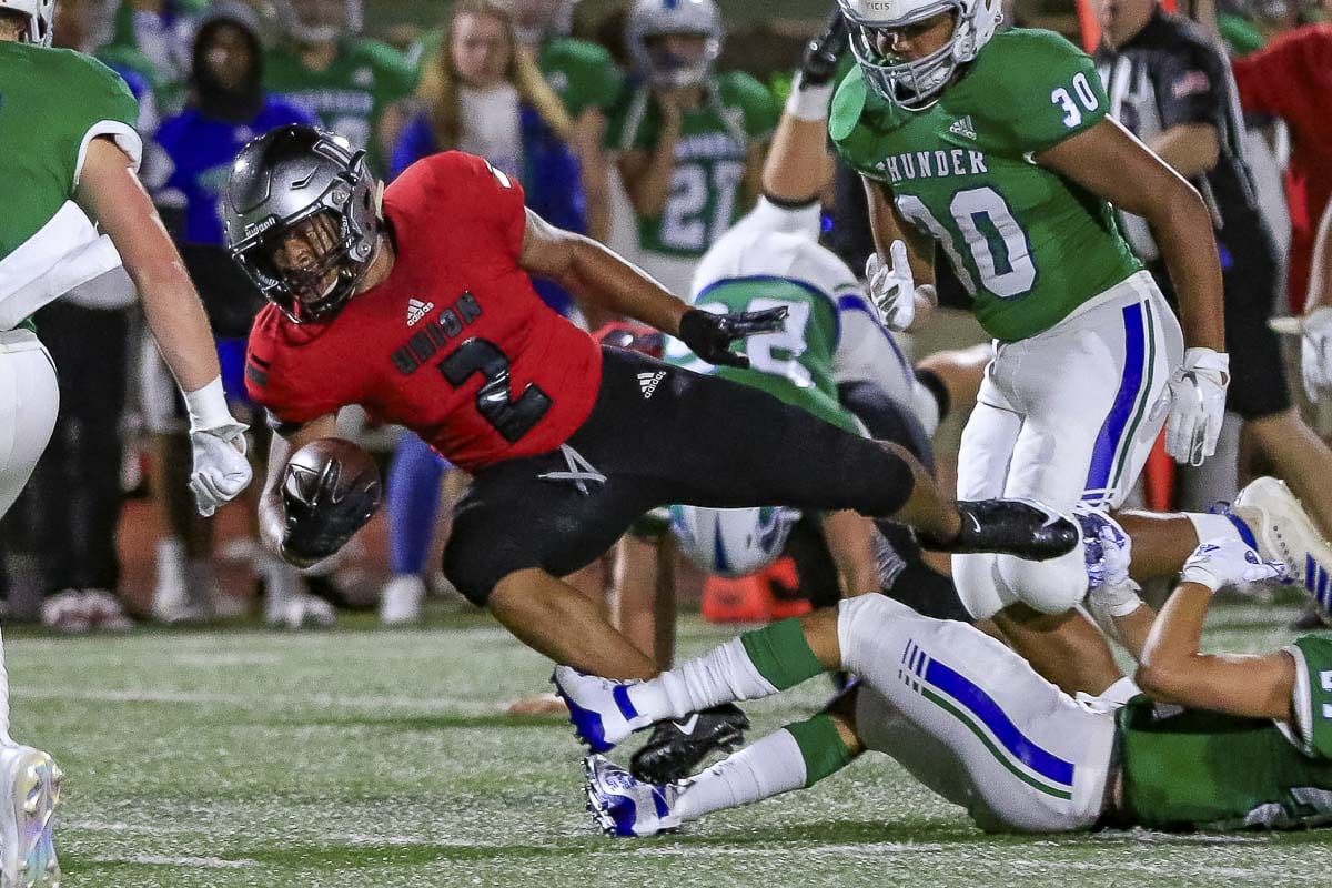 Union running back Isaiah Jones (2) rushed for 206 yards and three touchdowns to lead the Titans to a 20-10 non-league win over Mountain View Friday night at McKenzie Stadium. Photo by Mike Schultz