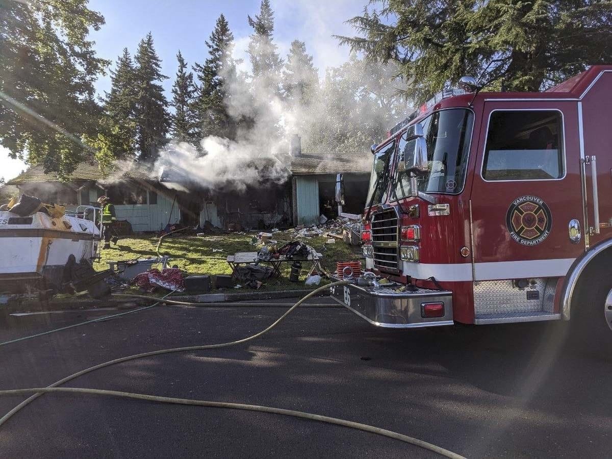 Vancouver Fire Department firefighters responded to a house fire at 12817 NE 14th street on Monday morning. Firefighters reported that a column of smoke could be seen from around the city while they were en route. Photo courtesy of Vancouver Fire Department