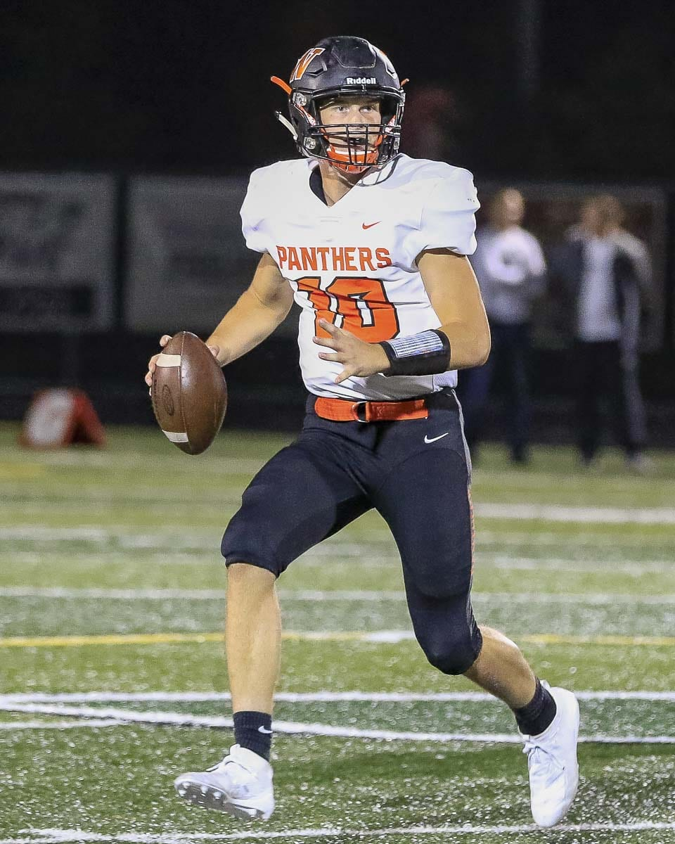 Washougal quarterback Dalton Payne looks downfield on his way to a 386-yard passing night. Photo by Mike Schultz