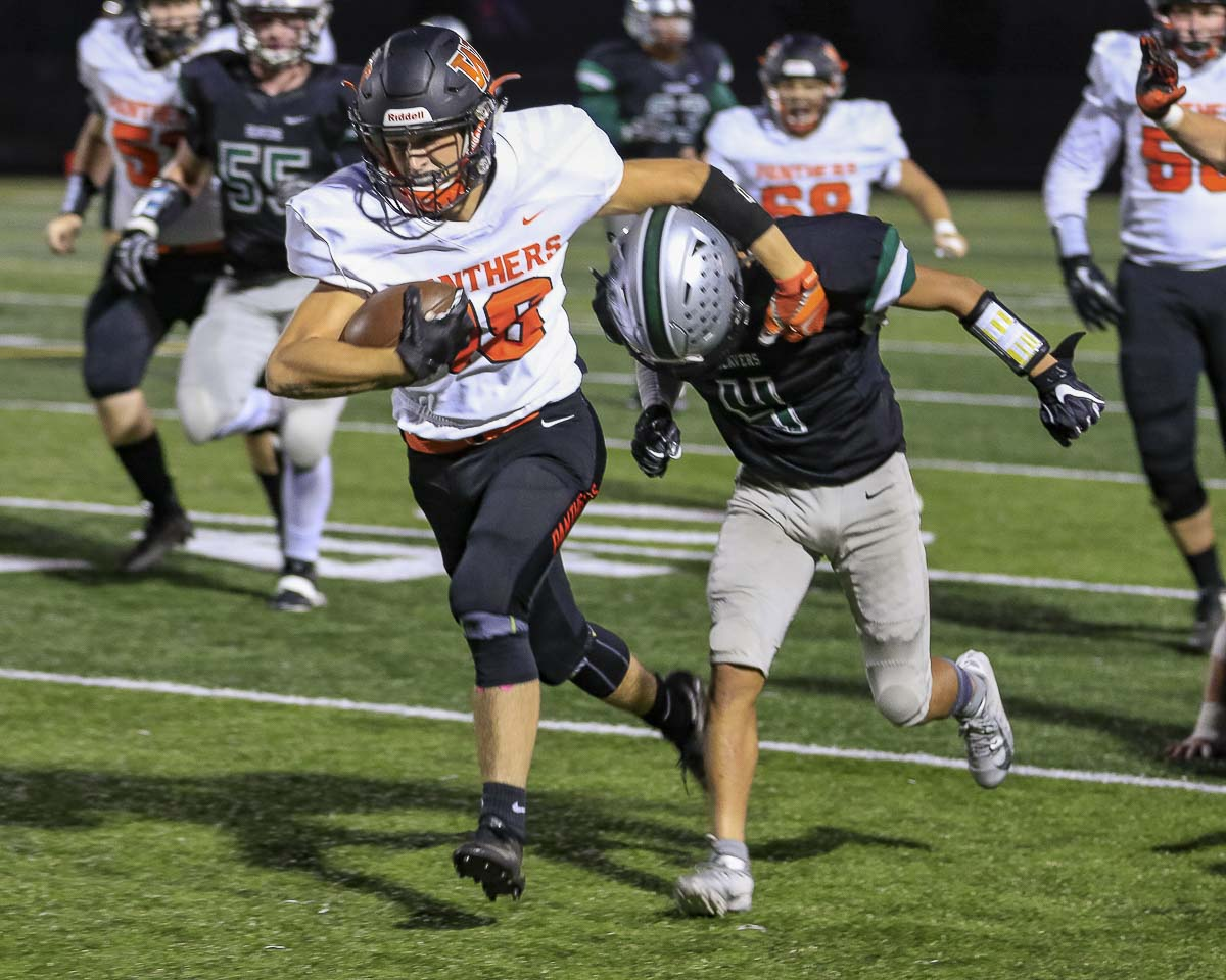 Washougal's Gavin Multer shakes free from a Woodland defender on his way to a 45-yard touchdown during Friday's win.Photo by Mike Schultz