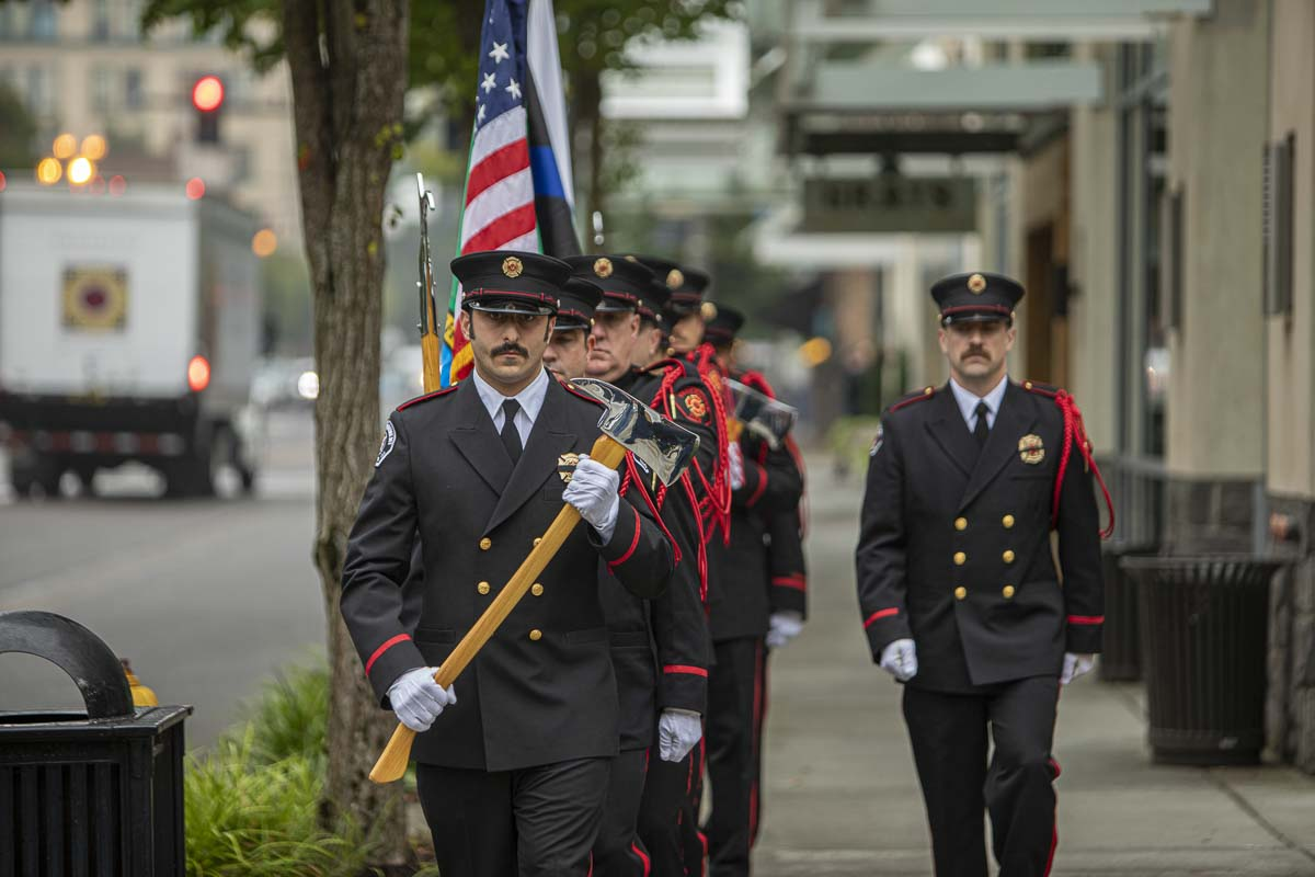 The Vancouver Police and Fire Honor Guards are shown here proceeding to post the colors. Photo by Jacob Granneman
