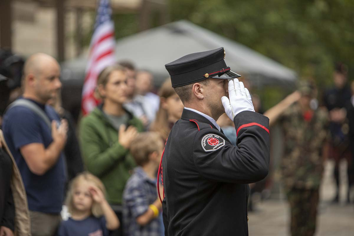 A member of the Fire Department Honor Guard salutes the flag during the 2019 Patriot Day ceremony. Photo by Jacob Granneman