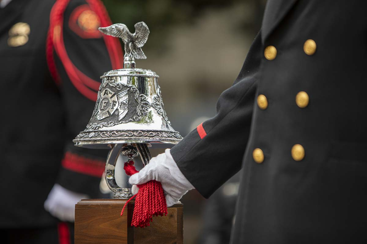 A member of the Fire Department Honor Guard is seen here ringing the bell that symbolizes the final alarm for firefighters. Photo by Jacob Granneman