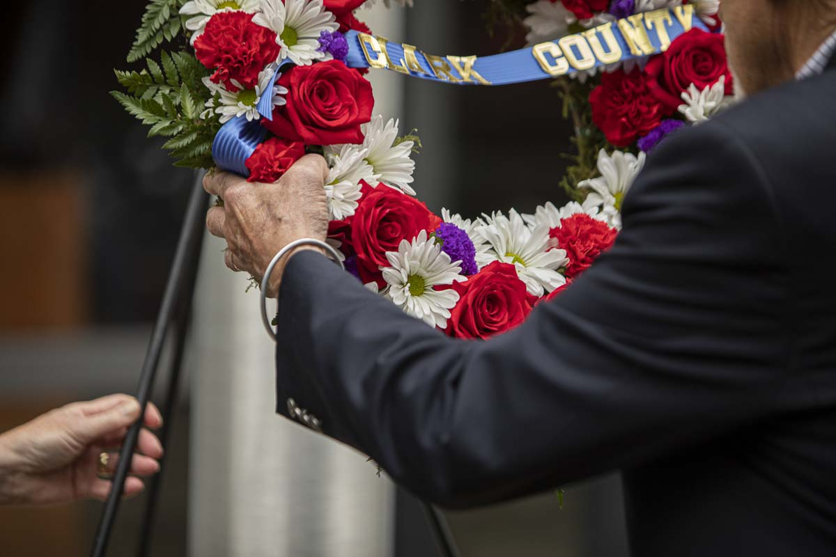 Col. Michael Burton (Ret.) USAF lays the ceremonial wreath during the 2019 ceremony remembering the 9/11 terrorist attacks. Photo by Jacob Granneman