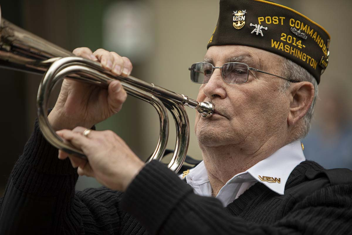 "Members of VFW Post 7824 perform ""Taps"" and deliver a rifle salute during the ceremony. Photo by Jacob Granneman"
