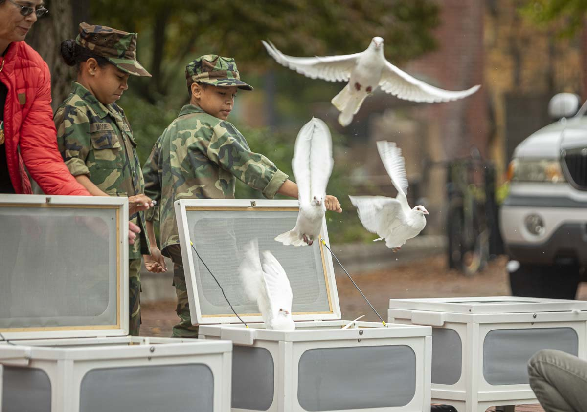 """Bright Eyes"" Doves releases doves with the Young Marines at the conclusion of the Patriot Day Salute ceremony. Photo by Jacob Granneman"