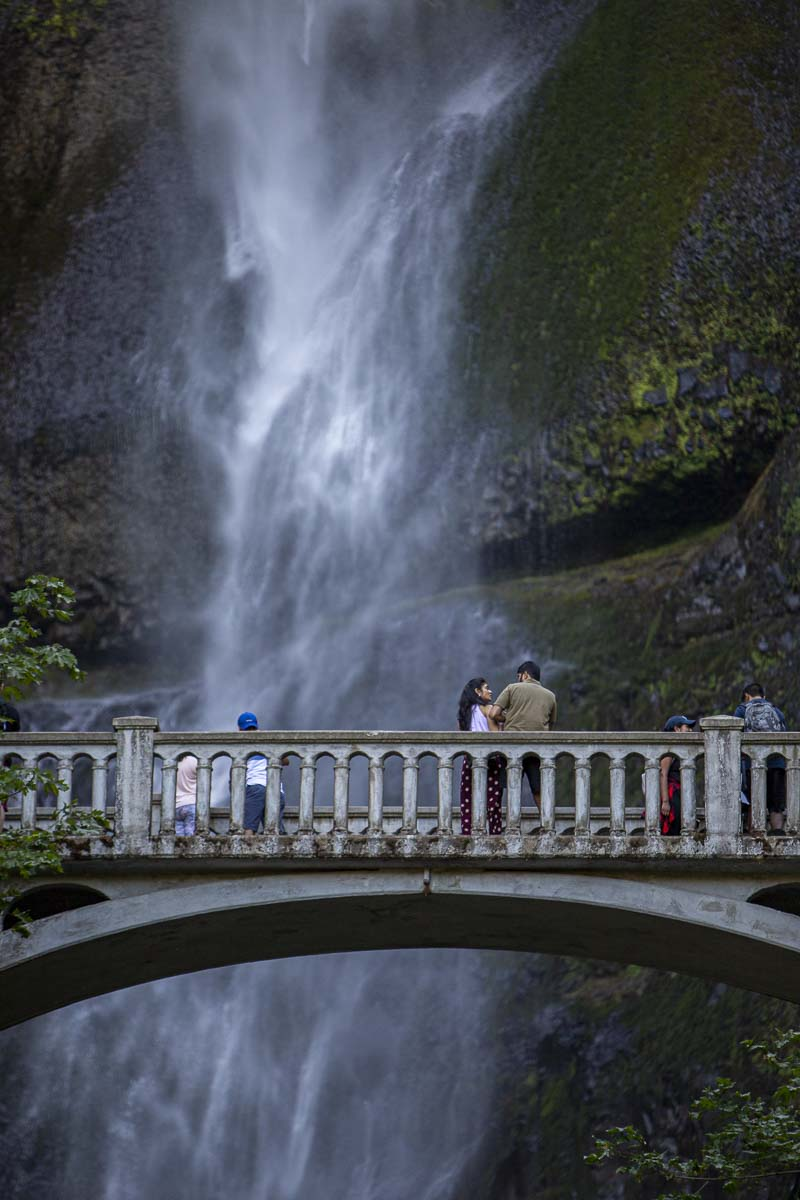 Visitors to Multnomah Falls can be seen here on the small footbridge that spans the lower falls. Photo by Bailey Granneman