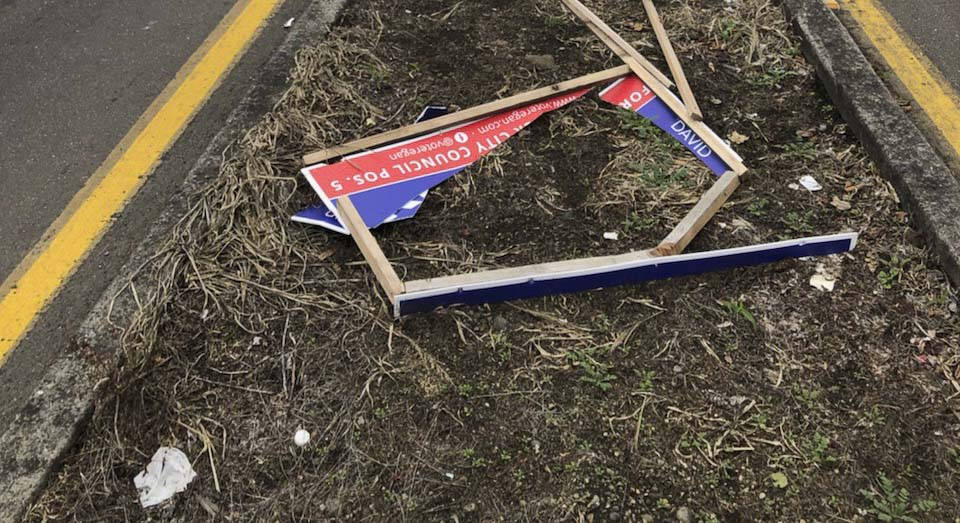 A campaign sign for Vancouver City Council Candidate David Regan is left destroyed in a yard. Photo courtesy David Regan