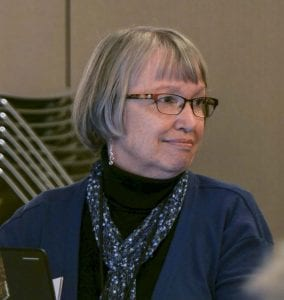FVRL Executive Director Amelia Shelley listens to public testimony at Tuesday's Board of Trustees meeting. Photo by Chris Brown