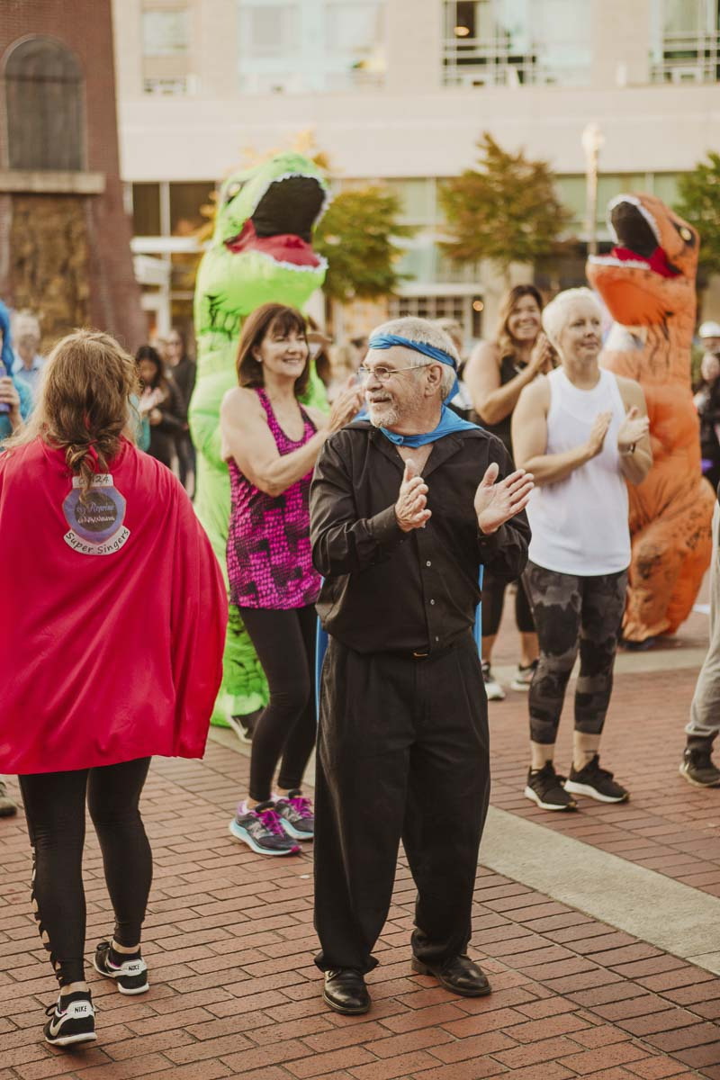 A dance class and contest will raise heart rates again this year, and surprise guest are always welcome. Last year, a pack of inflatable dinosaurs from Beaches Restaurant & Bar joined in the fun. Photo courtesy of Community Foundation for Southwest Washington