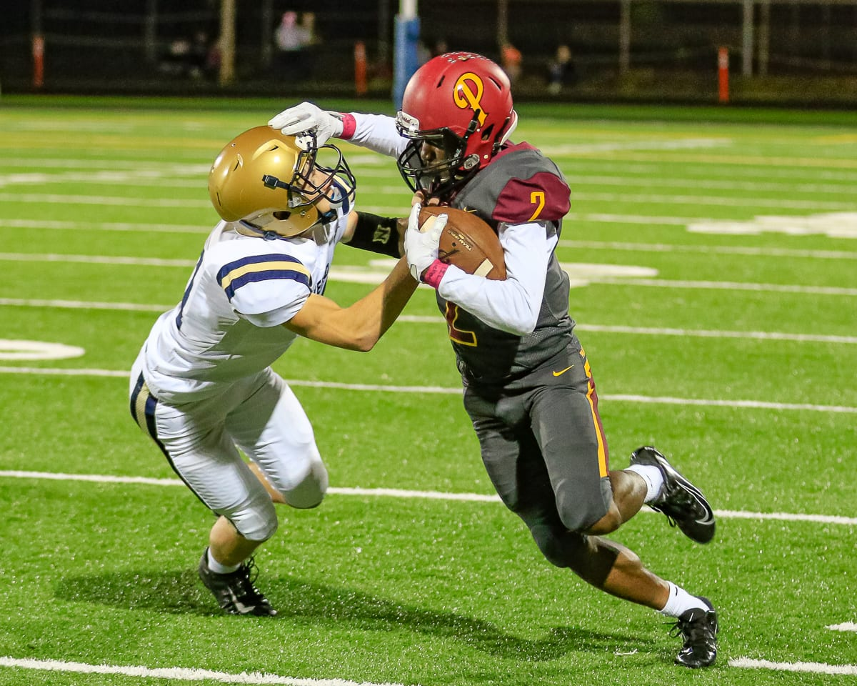 Prairie receiver Jimmie Barton (2) fights off a Kelso defender in Friday's Class 3A Greater St. Helens League action. Photo by Mike Schultz