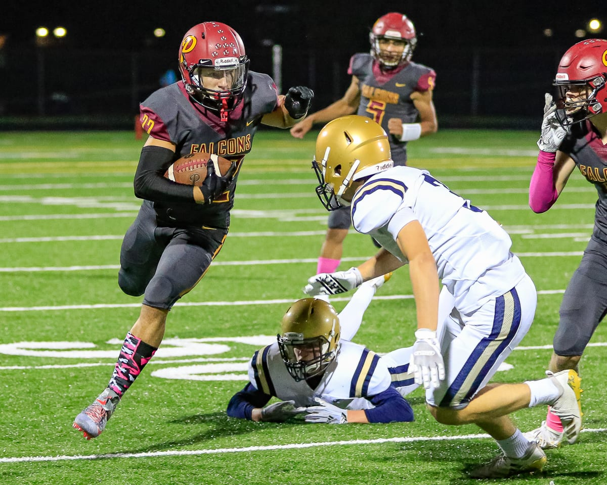 Prairie running back Dustin Shelby (22) looks for yardage in Friday's game with Kelso. Shelby had an 80-yard touchdown run in the Falcons' 38-22 win at District Stadium in Battle Ground. Photo by Mike Schultz