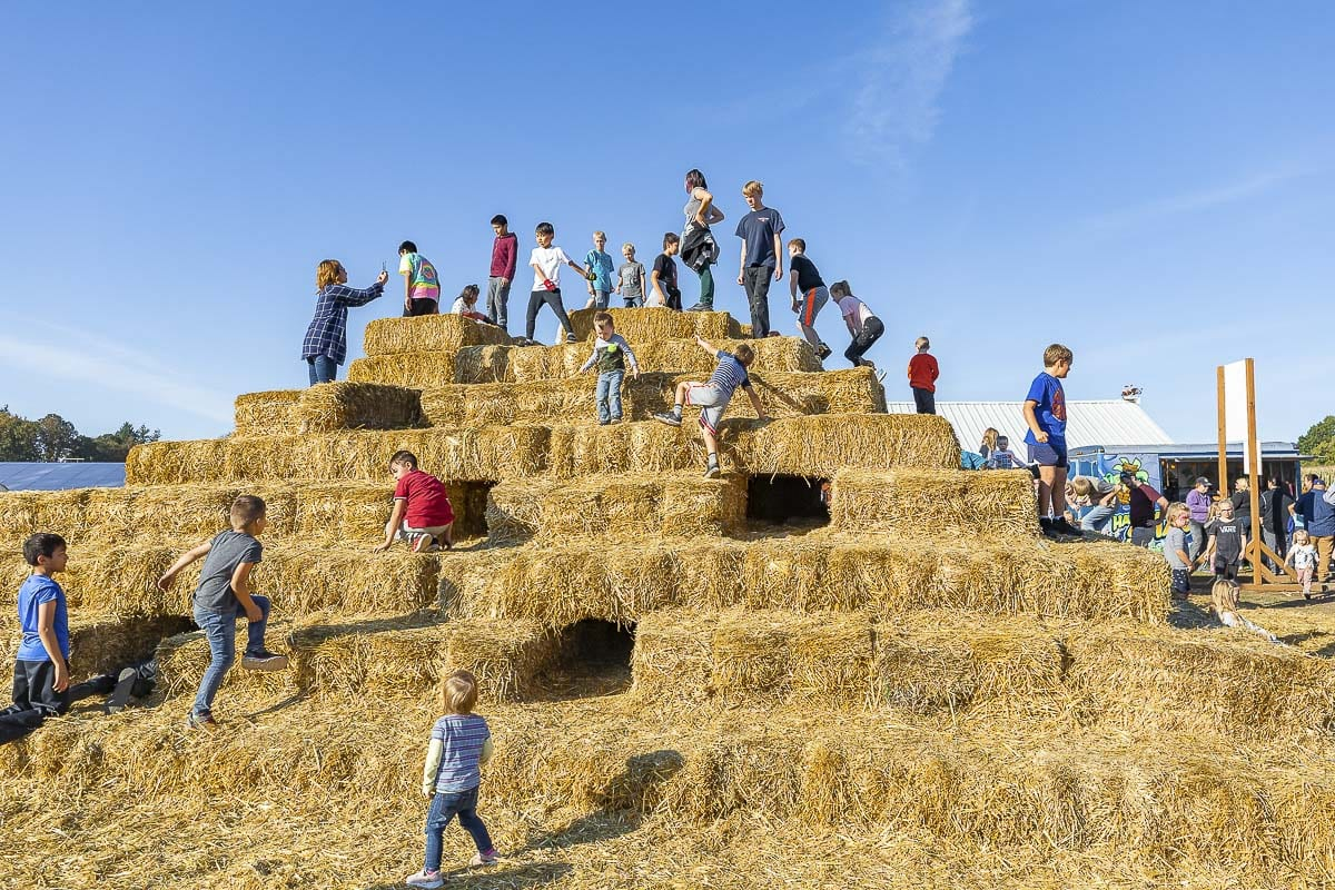 Bi-Zi Farms' iconic hay bale pyramid has been a sign of the annual opening day of the pumpkin patch for many years now. Children can run and crawl through tunnels inside. Photo by Mike Schultz