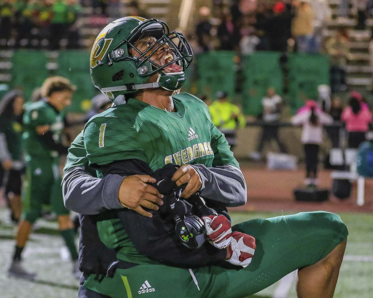 Evergreen receiver Zyell Griffin (4) celebrates his team's 40-35 victory over district-rival Mountain View Friday night at McKenzie Stadium. Photo by Mike Schultz