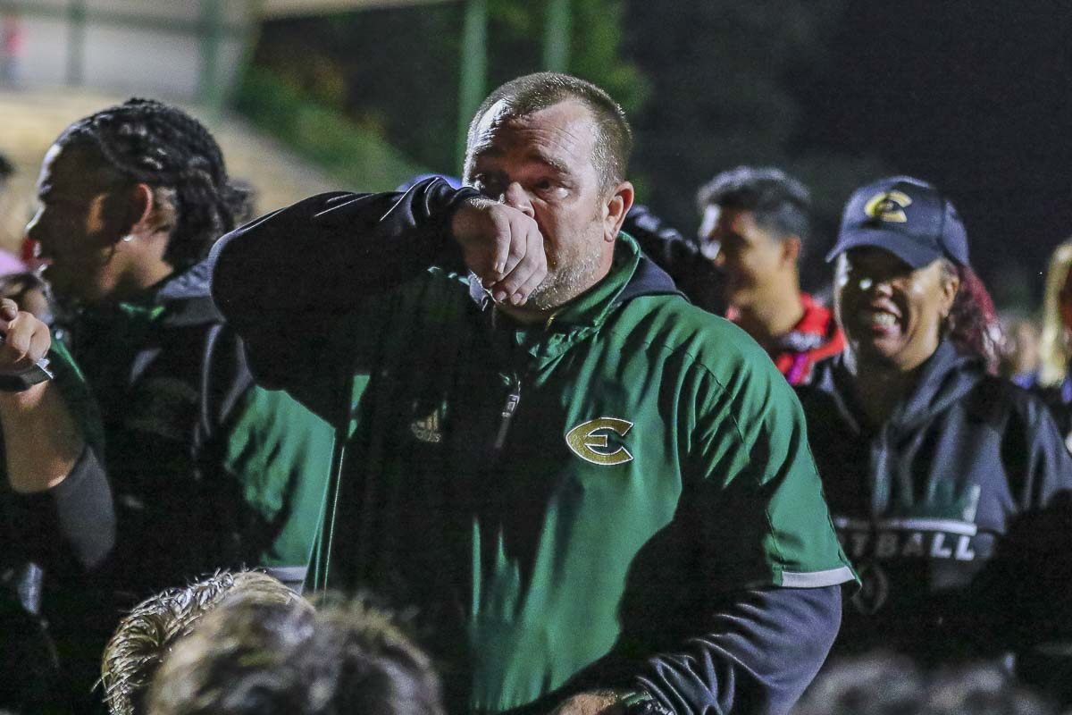 First-year Evergreen coach Christian Swain was emotional when he addressed his team after its 40-35 win over Mountain View Friday. Photo by Mike Schultz