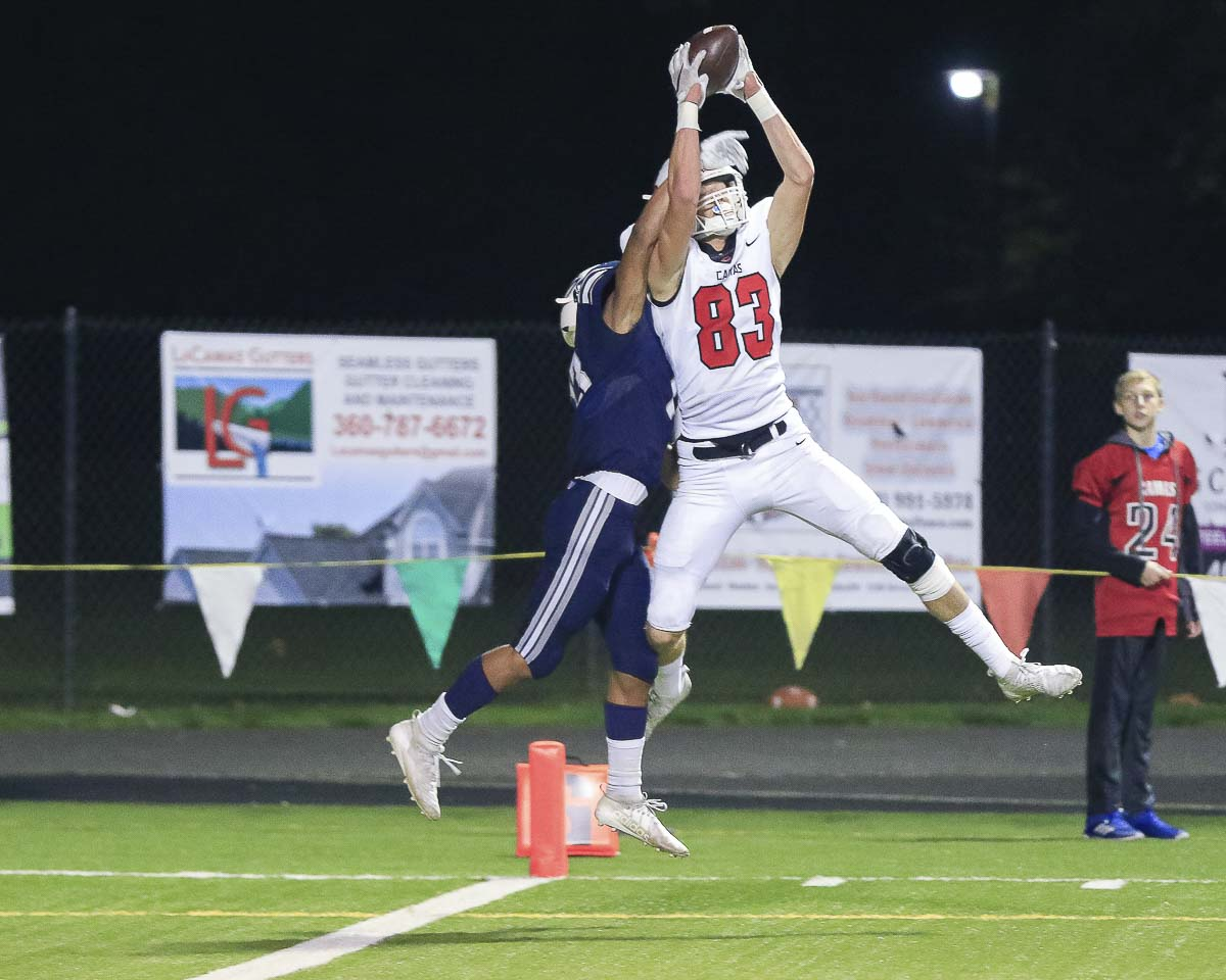 Camas receiver Jackson Clemmer (83) leaps high to haul in a touchdown pass during the Papermakers' 21-17 victory over Skyview Thursday at Kiggins Bowl. Photo by Mike Schultz