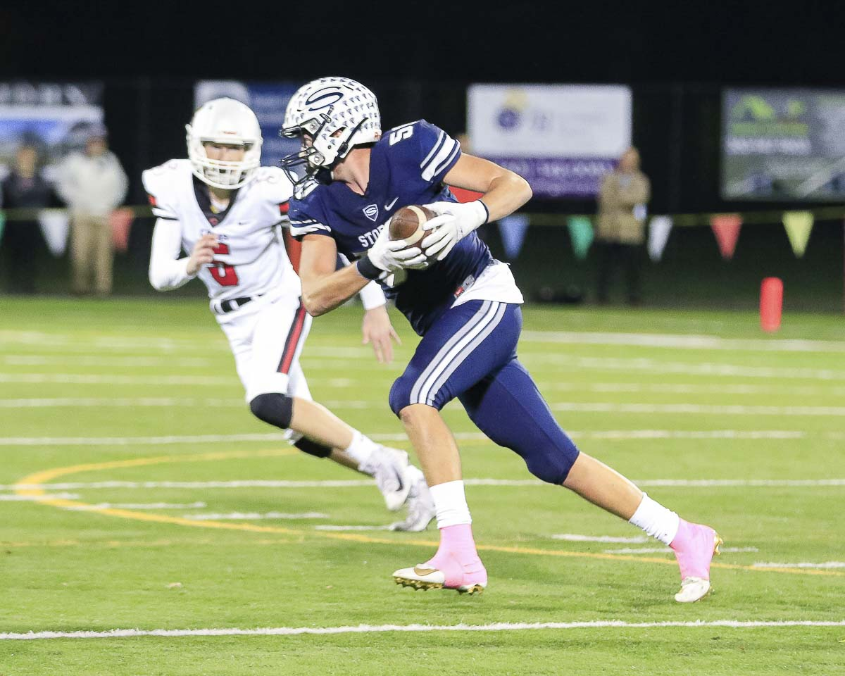 Skyview's Josiah Cochran (50) returns the football after intercepting a pass in the third quarter of Thursday's game at Kiggins Bowl. Photo by Mike Schultz
