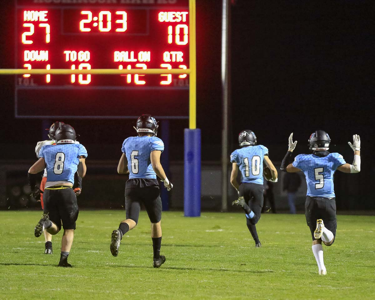 Liam Mallory and teammates head to the end zone on his pick-six to pretty much secure the Hockinson victory over Washougal on Friday night. Photo by Mike Schultz