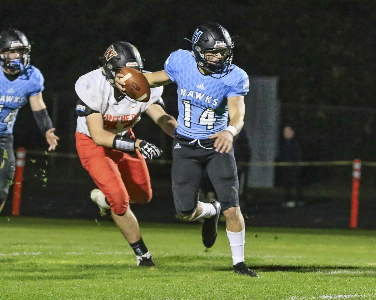 Hockinson quarterback Levi Crum threw for 396 yards and four touchdowns in the win over Washougal. Photo by Mike Schultz