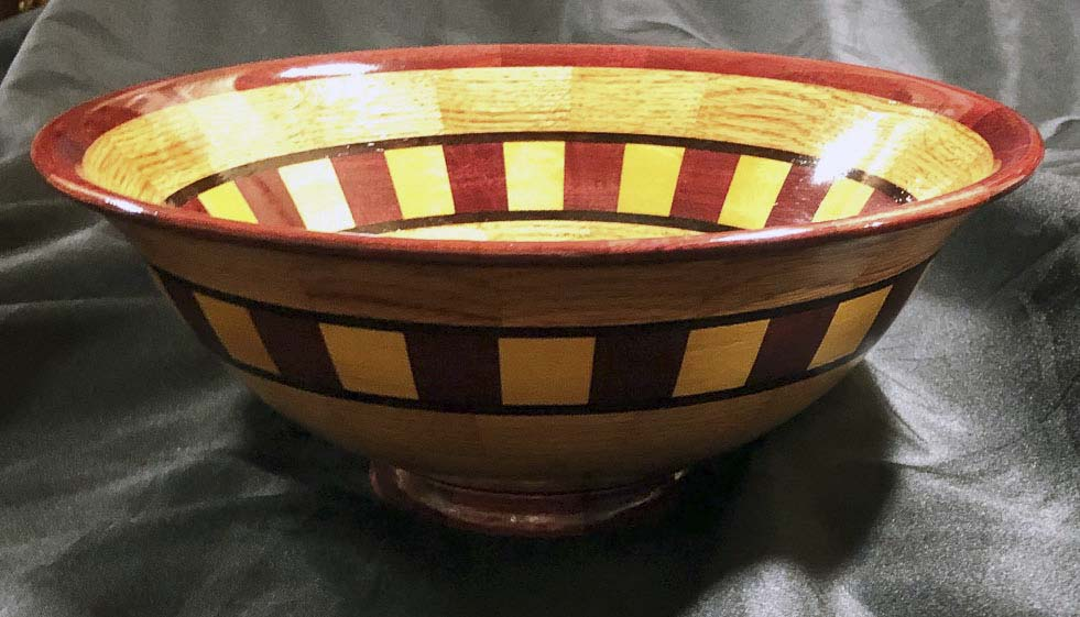 This hand-crafted, segmented bowl was created by Master Woodworker Terry Ellis, Photo courtesy of Friends of the Carpenter