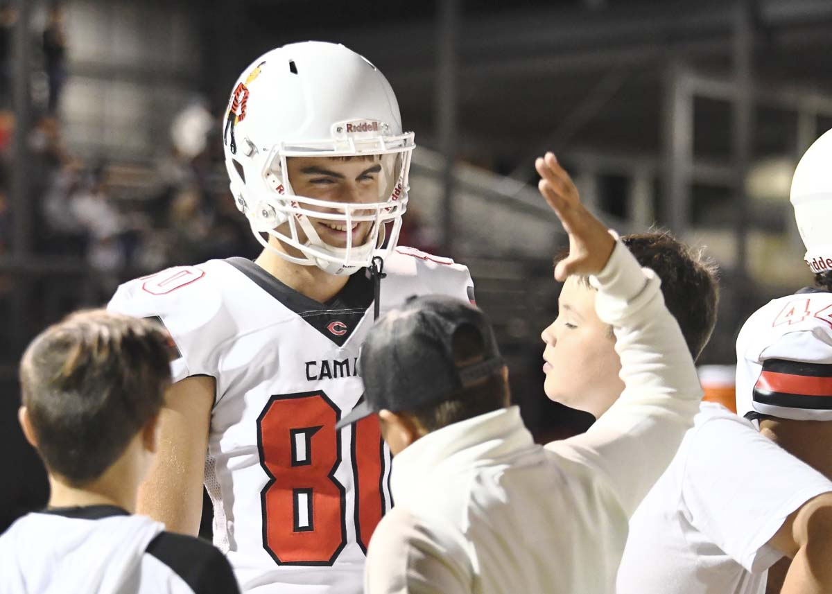 Camas punter Bryce Leighton shares a few minutes with youngsters earlier this season. Leighton is one of the best punters in the nation. Photo by Kris Cavin