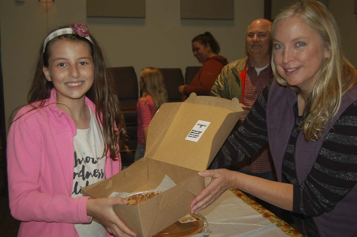 Event sponsor Carla Edwards (right) hands a pie to a winner at the 2018 event. Photo courtesy of Downtown Camas Association