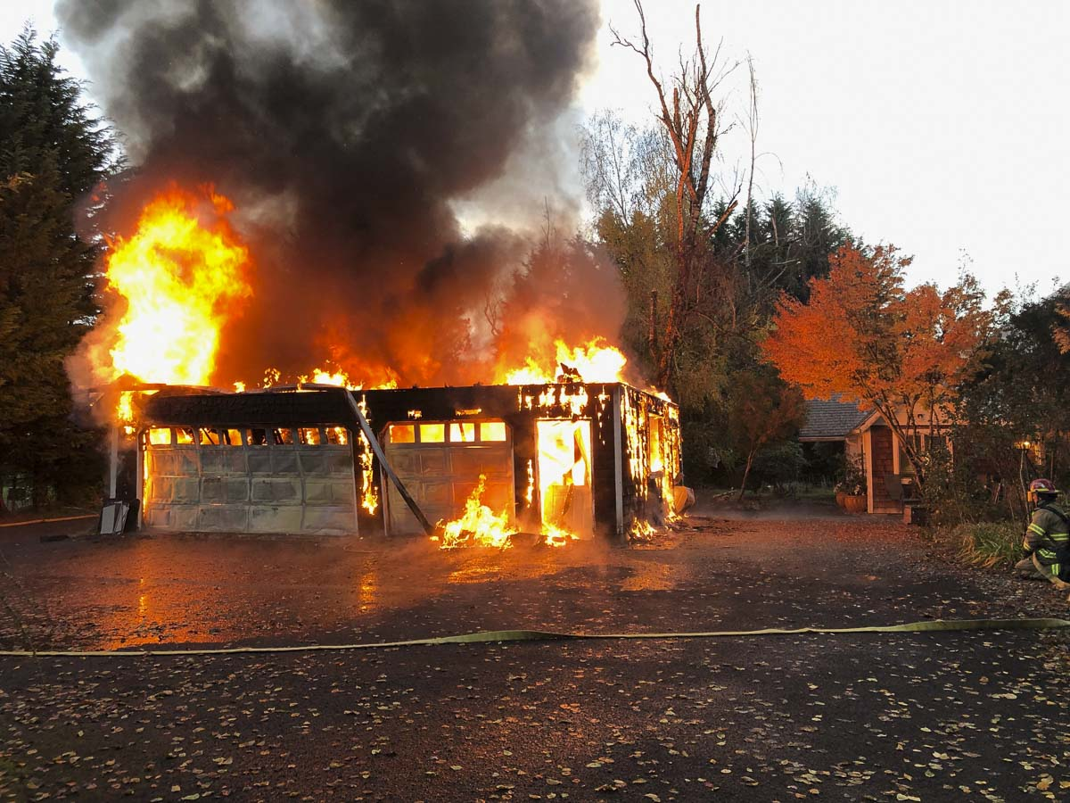 Clark County Fire & Rescue crews responded to a call of a garage fire at 8507 NE 199th Street Thursday morning. The first engine arrived to find a large detached garage fully involved in flames. The garage was approximately 15 feet from the main house. Photo courtesy of Clark County Fire & Rescue