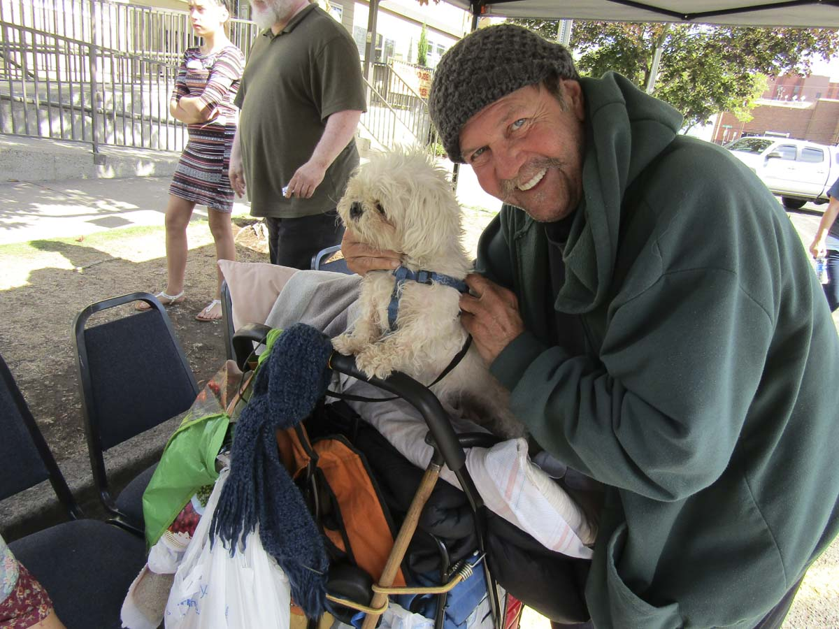 In years past, some 500 people have showed up to Open House's community block party for those in need; many making use of the free vet services. Photo courtesy of Open House Ministries