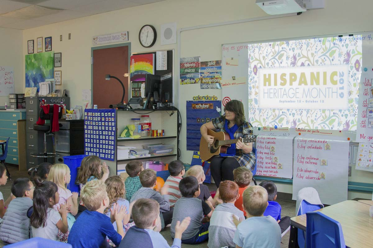 Maria Rodriguez, also an accomplished musician and singer, uses music and song to teach her first grade Dual Language students. Photo courtesy of Woodland Public Schools