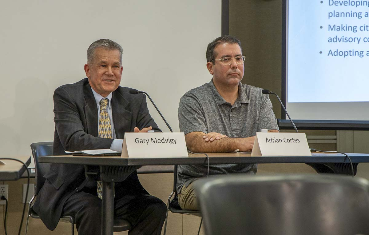 Gary Medvigy (left) and Adrian Cortes answer questions during a League of Women Voters candidate forum on the Clark County Council District 4 race. Photo by Chris Brown