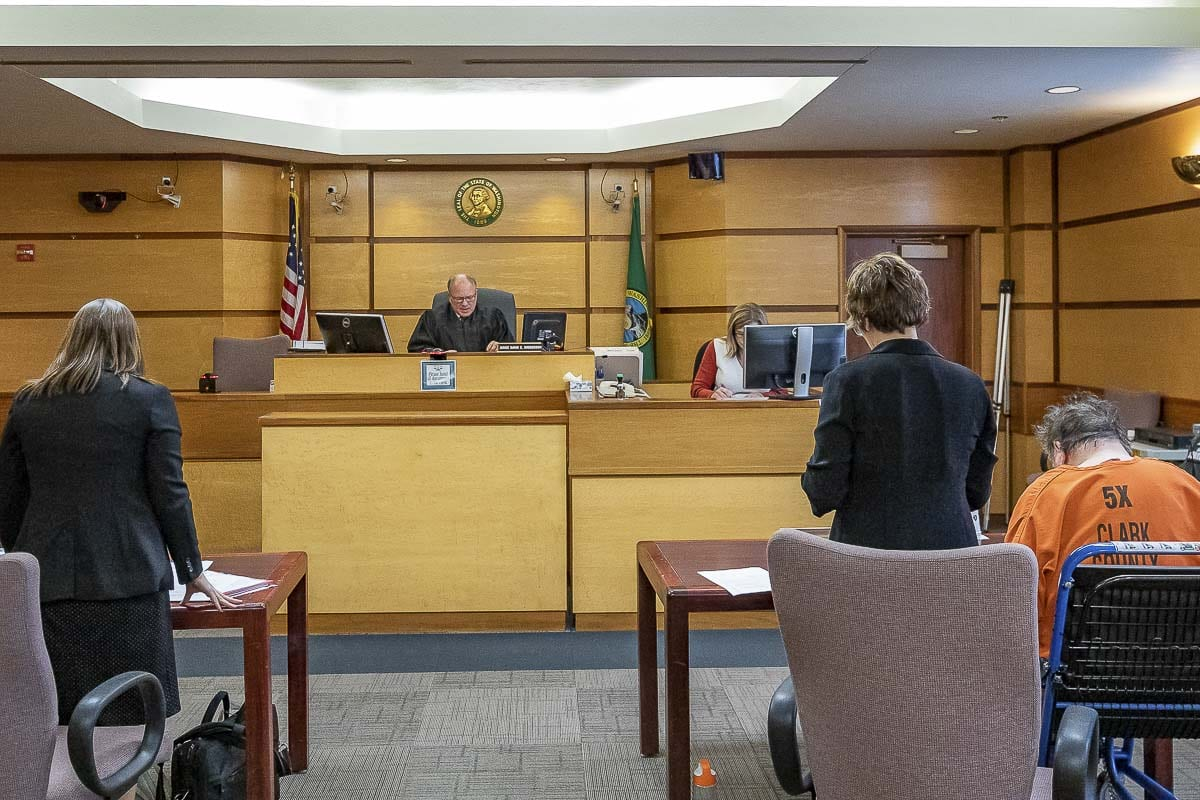 Judge David Gregerson presides over arraignment for Robert E. Breck on Thursday. Photo by Mike Schultz