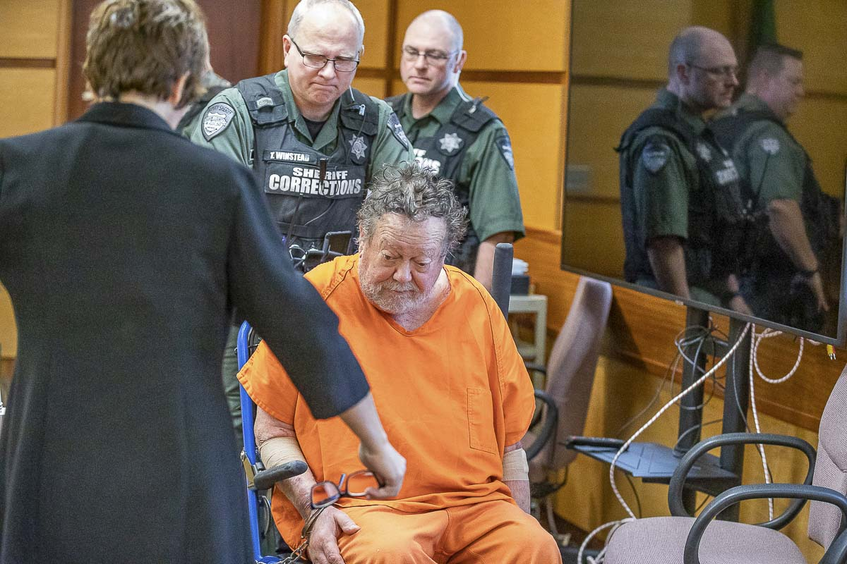 Robert E. Breck is wheeled into court on Tuesday. Breck is charged with shooting three people at Vancouver's Smith Tower last week. Photo by Mike Schultz