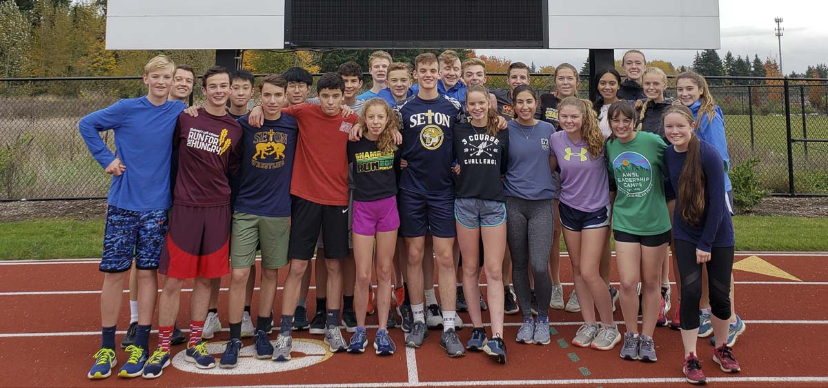The Seton Catholic Cougars hope to repeat last year's feat when the boys and girls teams both qualified for the state cross country meet. Photo by Paul Valencia