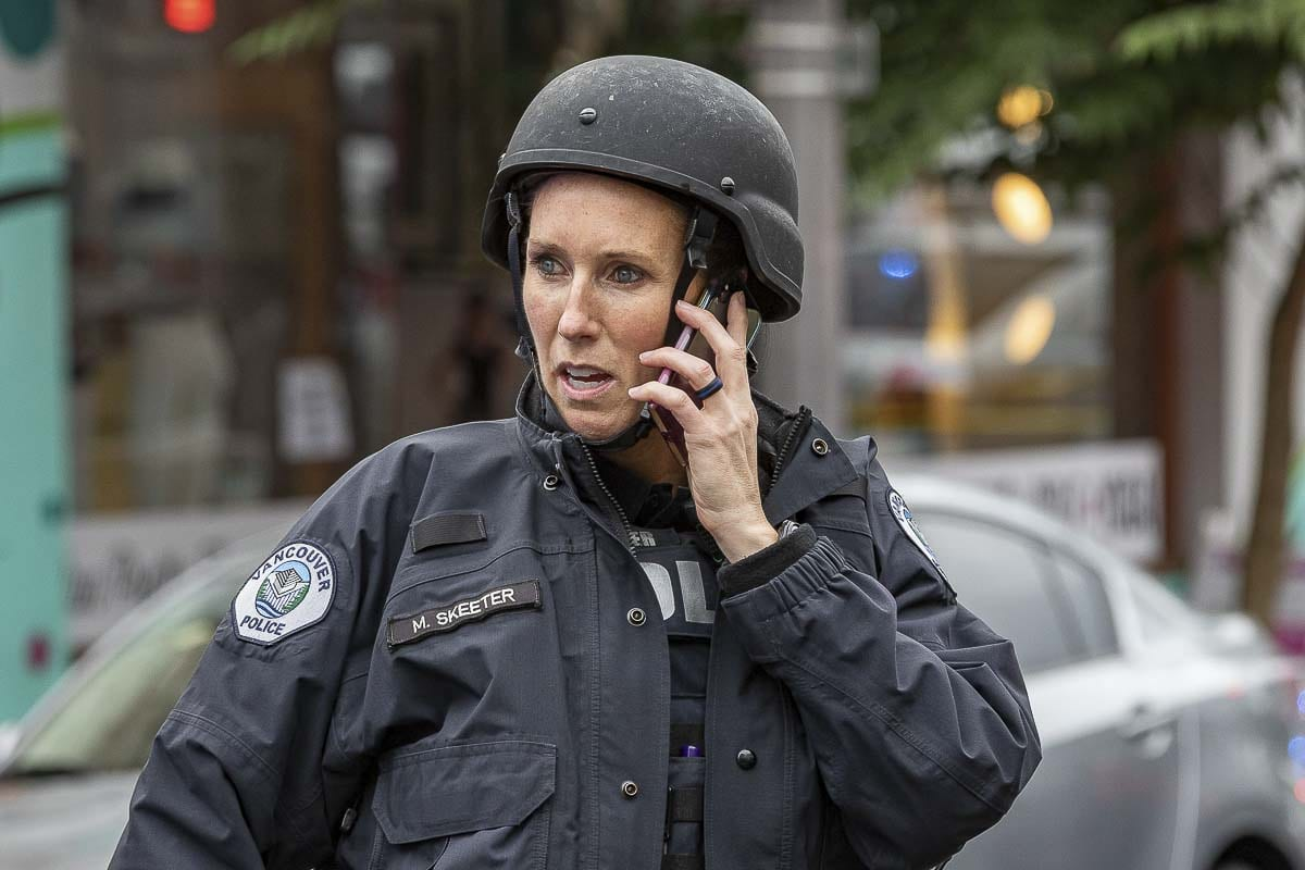 Vancouver Police Officer Missy Skeeter talks on the phone during an active shooter situation at Smith Tower on Thursday. Photo by Mike Schultz