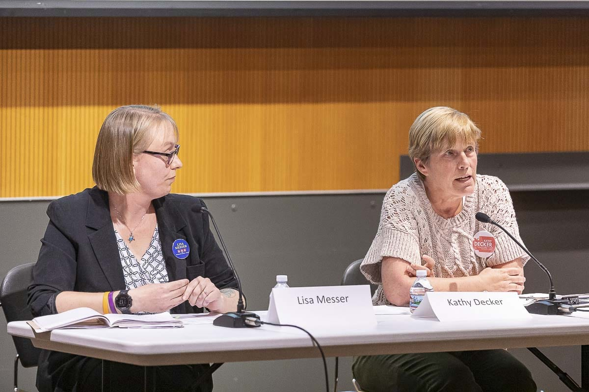 Lisa Messer (left) and Kathy Decker (right) exchange ideas at a recent League of Women Voters Candidate Forum held in Vancouver. The two are vying for a seat on the Vancouver Public Schools Board of Directors. Photo by Mike Schultz