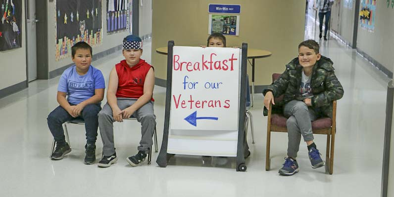 Students at Captain Strong Primary School greet veterans as they arrive for a breakfast in their honor. Photo courtesy of Battle Ground Public Schools