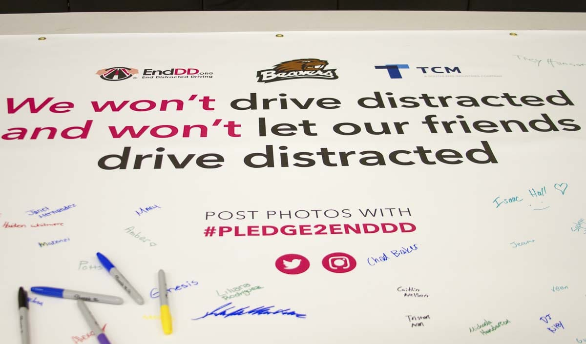 Students had the opportunity to sign a banner pledging not to drive distracted or let others drive distracted. Photo courtesy of Woodland Public Schools