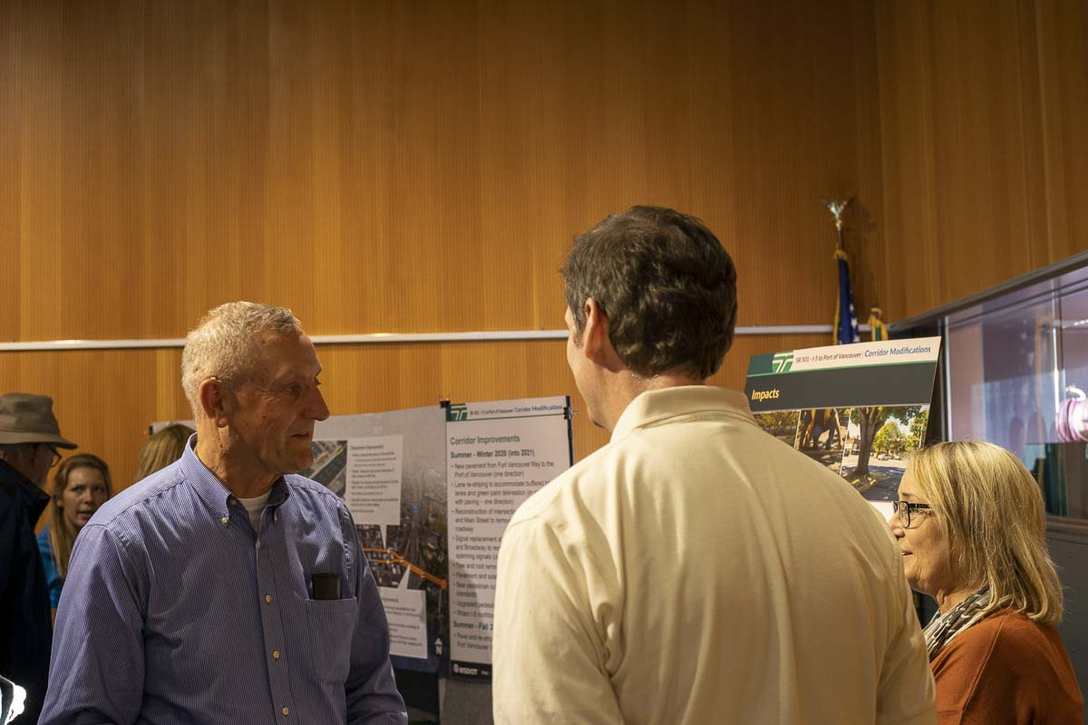 People ask questions of officials with WSDOT and the city of Vancouver during an open house at the Vancouver Community Library on upcoming projects for I-5. Photo by Chris Brown
