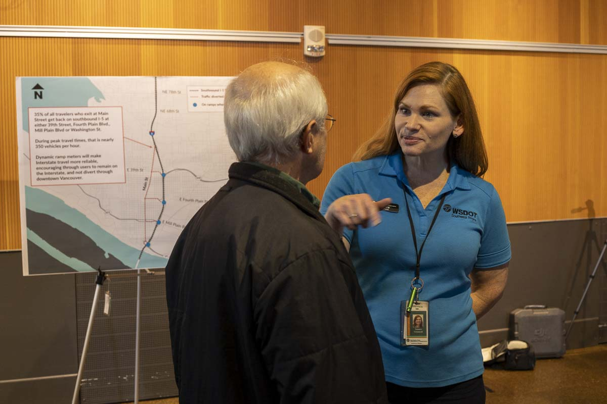 Tamara Greenwell, spokesperson for WSDOT SW Region, talks with a citizen during an open house at Vancouver Community Library. Photo by Chris Brown