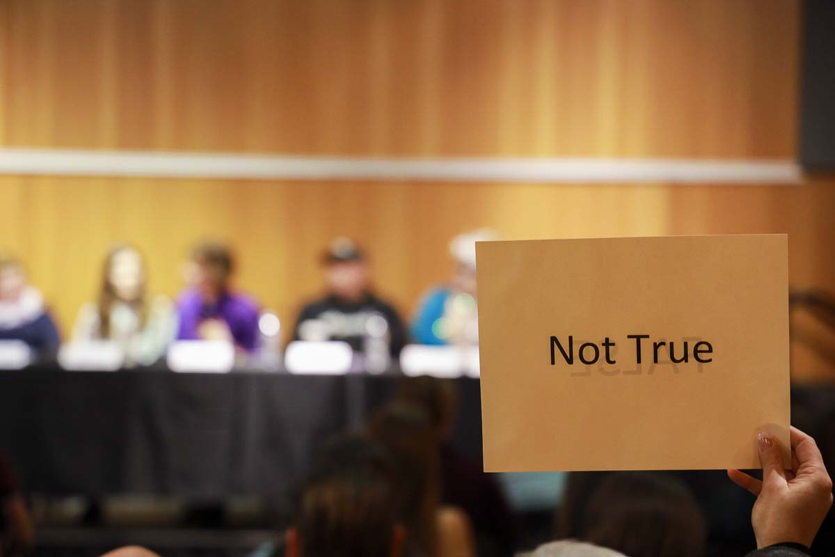 Protestors were largely silent, but held up signs of disagreement during a panel discussion on Drag Queen Story Hour at the Vancouver Community Library. Photo by Chris Brown