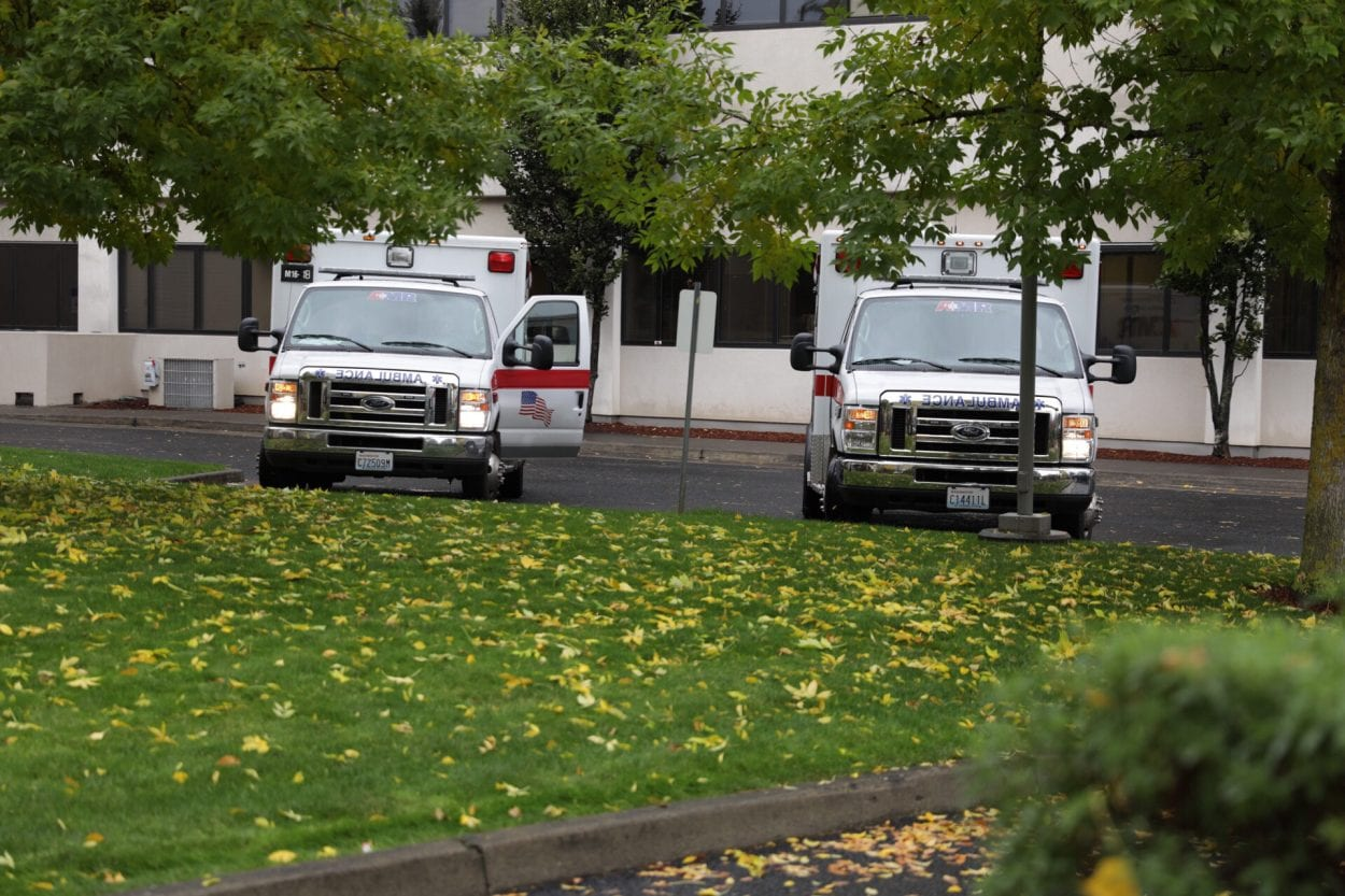 AMR Ambulances wait outside PeaceHealth Southwest Medical Center. Two people were transported there following a shooting at the Smith Tower in downtown Vancouver on Thursday afternoon. Photo by Jacob Granneman