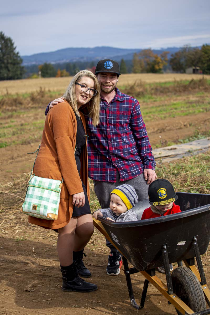 Brian Marteeni (upper left) and Angel Campbell (upper right) pose for a photo while at the Vancouver Pumpkin Patch with Brian's two boys, Eli (left) and Wyatt Marteeni (right). Photo by Jacob Granneman